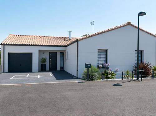 Maison 3 chambres moderne et arborée de 107 m²
